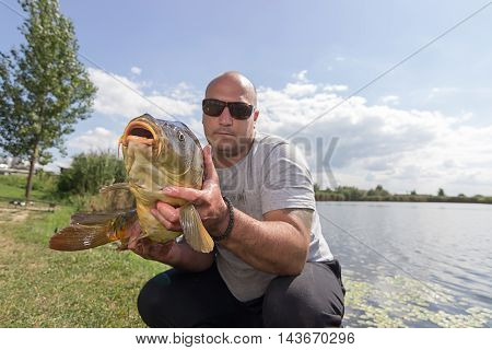 Angler with carp fishing trophy Carp and Fisherman, Carp fishing trophy
