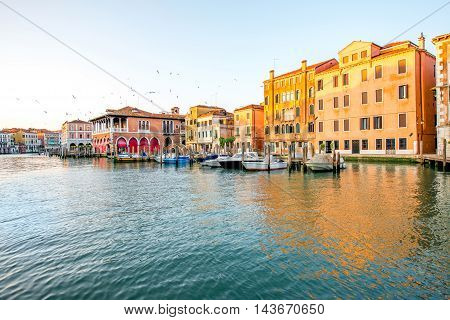 Venice cityscape view on Grand canal with colorful buildings and boats at the sunrise
