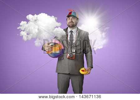 Businessman wearing holiday gear with cloud at office