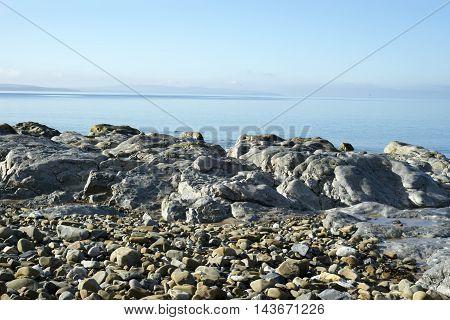 beautiful soft waves break on the rocks at ballybunion beach in ireland