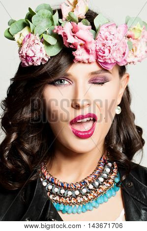 Beautiful Fashion Woman Winking. Makeup Hairstyle Flowers. Funny Face