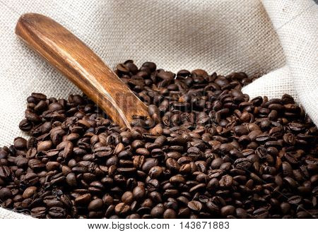 white sackcloth full of toasted coffee beans