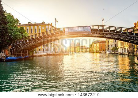 View on Accademic wooden bridge on Gran canal at the sunrise in Venice