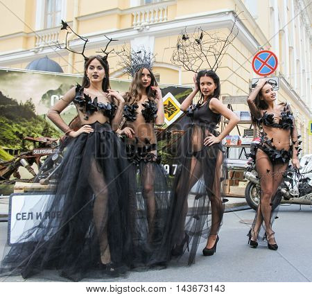 St. Petersburg, Russia - 12 August, Group models posing on the street, 12 August, 2016. The annual International Motor Festival Harley Davidson in St. Petersburg. Girls model in designer dress posing on the street.