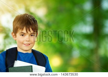 Boy with rucksack in the park. Child with a backpack