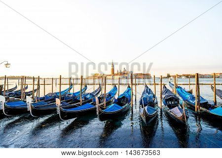 Venice landscape view on San Giorgio Maggiore island with gondolas on the foreground