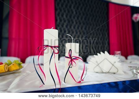Two candles on catering service. Restaurant table with food at event