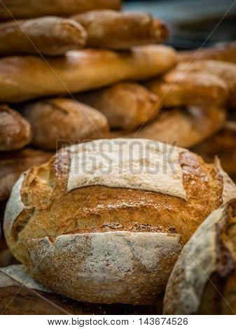 Close up of freshly baked bread on market stall in Borough market in London