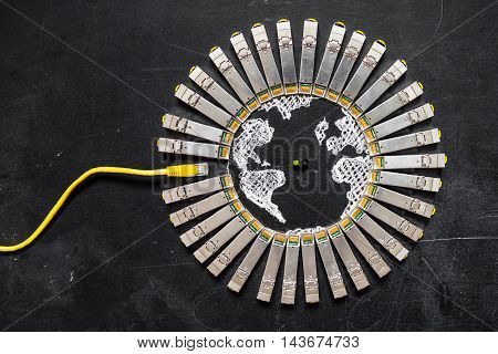 Internet SFP network modules as the shape of Earth and RJ45 ethernet cable for communication and green diode on the black background.Concept of internet security/computer data encryption / data protection / security enhancement