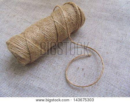 Organic jute thread hank on linen background
