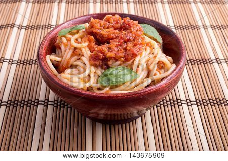 Thin Spaghetti With Tomato Relish And Basil Leaves