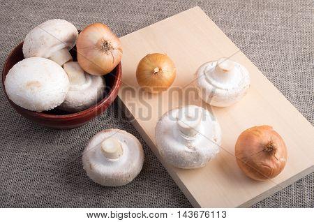 Raw Champignon Mushrooms And Onions