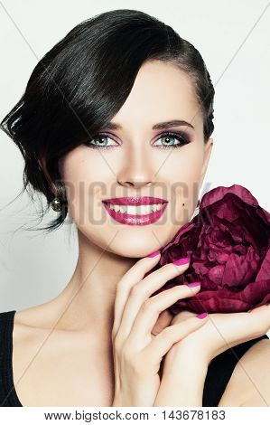 Smiling Girl with flower. Cute Face. Toothy Smile
