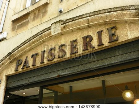 View of exterior of antique bakery shop in small town in france