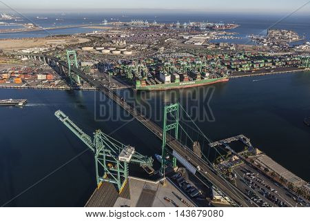 Los Angeles, California, USA - August 16, 2016:  Afternoon aerial view of the Port of Los Angeles, Terminal Island and the Vincent Thomas Bridge.