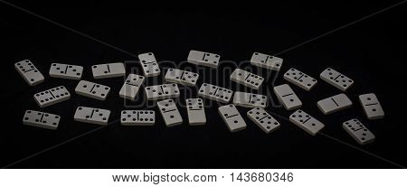 Dominoes chips isolated on a black background