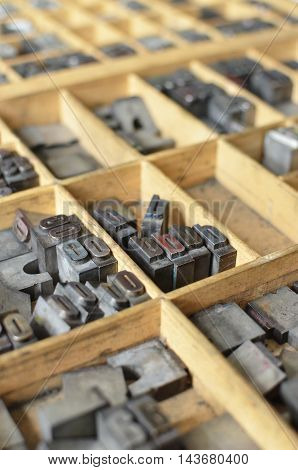 Side View Of Letterpress Letters In A Wooden Box