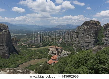 Mountain valley the monasteries of Meteora in Greece with rocks and lush greenery Sunny day