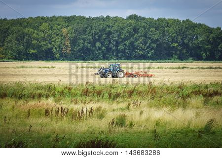 Harvest time with the tractor in the biesbosch national park