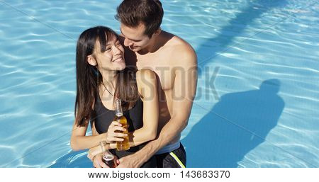 Young beautiful mixed race couple in the pool