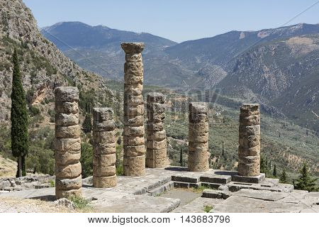 Mountain landscape with views of ancient ruins of the temple of Apollo in Delphi on a Sunny day