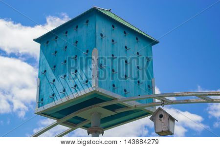 Big beautiful birdhouse on a background of blue sky