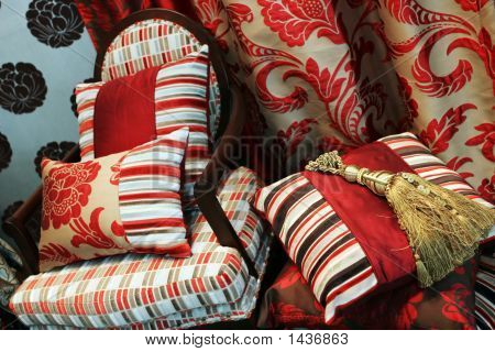 Luxurious Red Chair With Satin Pillows
