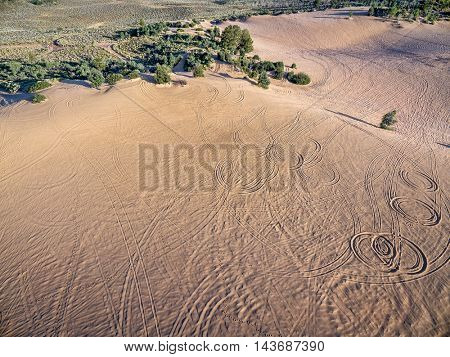 footprints and vehicle tracks on sand at North Sand Hills, only place in Colorado to legally ride on sand dunes - aerial view