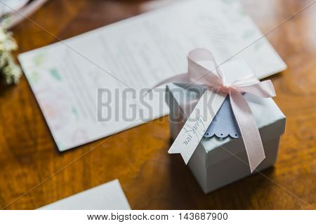 Blue gift box with lettering Thank you on wooden table