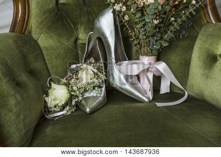 Bridal bouquet, wedding flowers for the ceremony on the chair with shoes