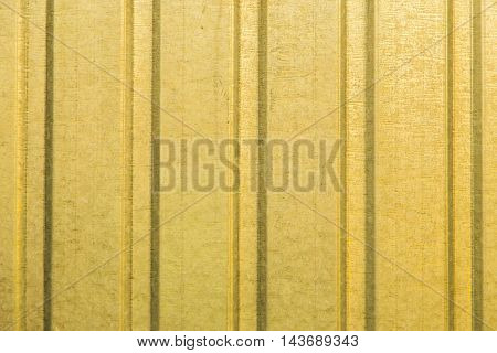 Corrugated yellow metal sheet wall background texture