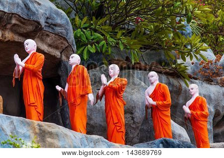 Dambulla Cave Temple Buddhist Monk statues Dambulla Sri Lanka Buddhist monks at Dambulla Sri Lanka