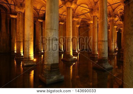 ISTANBUL TURKEY - JULY 28 2016: Columns and water inside Basilica Cistern. The Basilica Cistern is the largest of several hundred ancient cisterns that lie beneath the city of Istanbul.
