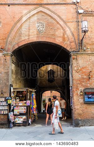 Street Scene In The Old Town Of Siena, Italy