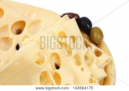 gold edam cheese sliced on wooden platter with olives and tomato isolated over white background
