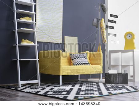 Stylish room interior with yellow couch
