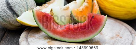 Bitten Watermelon In Front Of Others