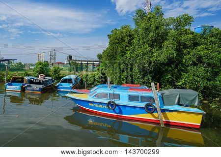 Menumbok,Sabah-Aug 19,2016:Colourful taxi speedboats Menumbok to Labuan island at Menumbok terminal.It is a passenger taxi service operator & tourist attraction to Labuan Pearl Of Borneo.