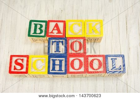 Back To School Written In Wooden Cubicle Letters