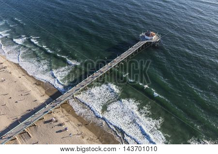 Manhattan Beach, California, USA - August 16, 2016:  Afternoon aerial view of Manhattan Beach Pier and the Pacific Ocean near Los Angeles California.