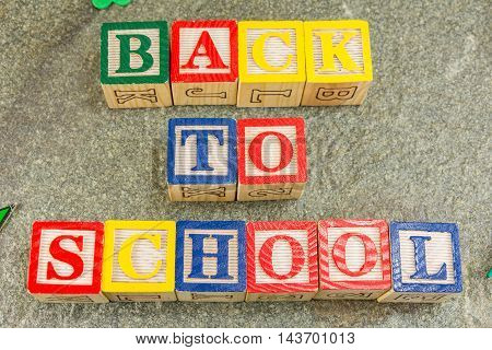 Back To School Written With Wooden Letters On Stone
