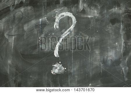 Question mark written on a dirty blackboard