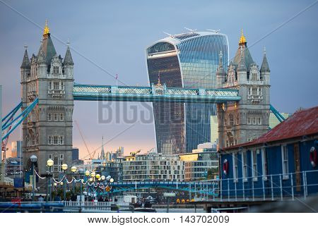 LONDON, UK - SEPTEMBER 19, 2015: City of London with first night lights at sunset. Modern business and banking aria. View from the Tower bridge include Walkie-Talkie building