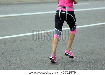 feet running athlete woman at the distance of a marathon