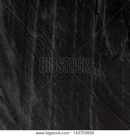 Dark grey black slate background or texture.