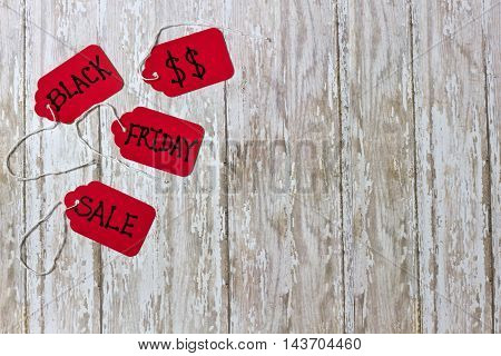 Red Black Fraday Sales Tickets on a white washed wood background with room for copy space or negative space