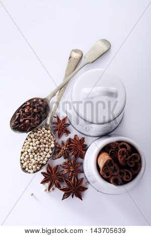 spices jar and spices on the white background