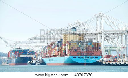Oakland CA - July 27 2016: The Port of Oakland loads and discharges more then 99 percent of containerized goods moving through Northern California the nations fourth largest metropolitan area.