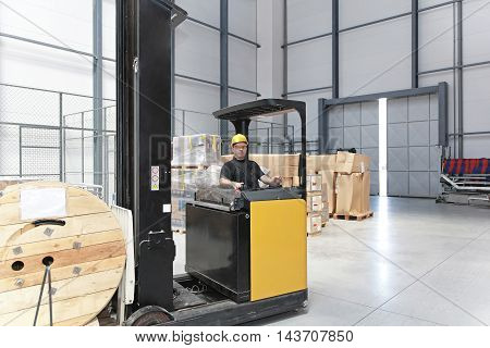 Forklift With Reel Pallet in Distribution Warehouse