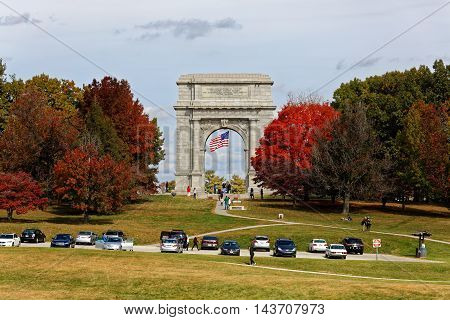 VALLEY FORGE PA- OCTOBER 24 2015: Visitors at the National Memorial Arch in Valley Forge PA. This monument is dedicated to George Washington and the United States Continental Army.